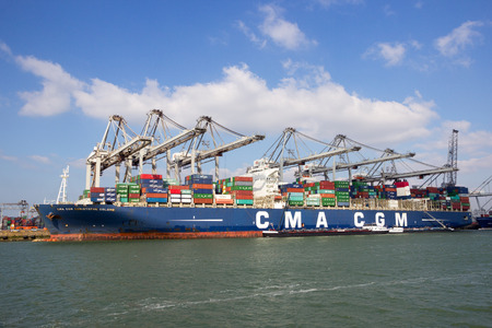 rotterdam: ROTTERDAM, NETHERLANDS - MAR 16, 2016: Container ship Christophe Colomb from CMA CGM moored at a container terminal in the Port of Rotterdam.