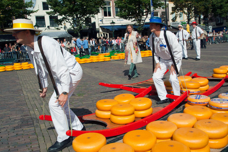 holland: ALKMAAR, HOLLAND, THE NETHERLANDS - SEPTEMBER 3: Cheese carriers at the famous Dutch traditional cheese market September 3, 2010 in Alkmaar, Holland, The netherlands