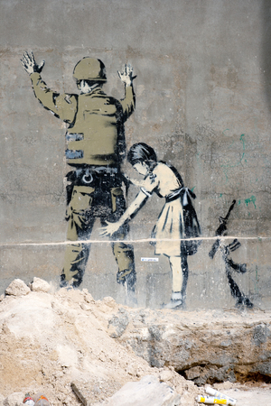 BETHLEHEM, PALESTINIAN TERRITORIES - JANUARY 25: Banksy grafitti on a wall in the occupied territories. Bethlehem, JANUARY 25, 2010.