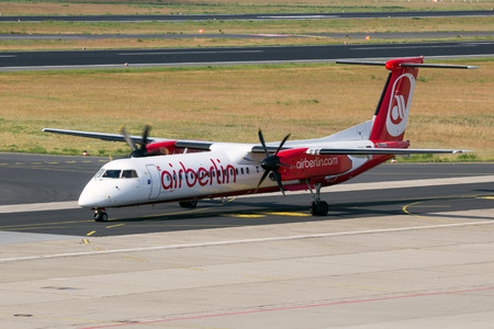 bombardier: BERLIN - JUN 1, 2016: Bombardier Q400 from AirBerlin taxiing before take-off at Berlin-Tegel airport