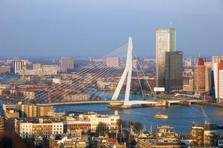 rotterdam: ROTTERDAM, NETHERLANDS - MAR 16, 2016: View on the Erasmus bridge and the city centre of Rotterdam