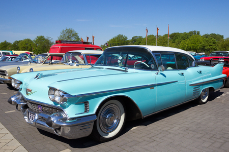 caddie: DEN BOSCH, THE NETHERLANDS - MAY 8, 2016: 1958 Cadillac Sedan De Ville on the parking lot at the Rock Around The Jukebox event.