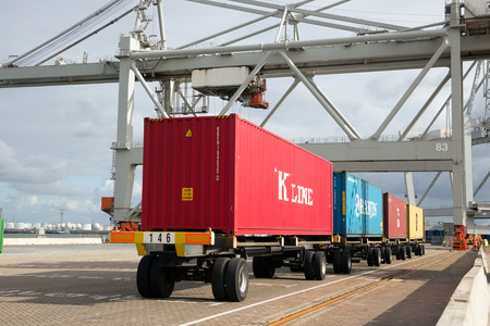 transported: ROTTERDAM, NETHERLANDS - SEP 6, 2015: Row of containers ready to be transported onto a ship in a container terminal in the Port of Rotterdam Editorial