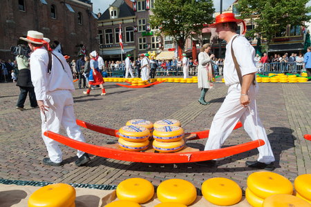 netherlands: ALKMAAR, HOLLAND, THE NETHERLANDS - SEPTEMBER 3: Cheese carriers at the famous Dutch traditional cheese market September 3, 2010 in Alkmaar, Holland, The netherlands