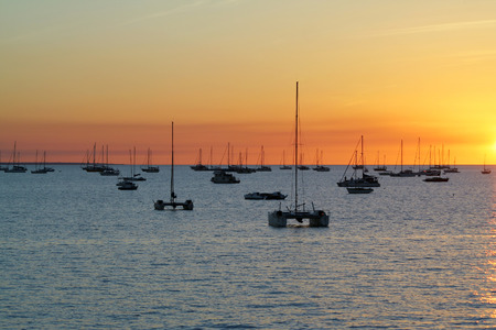 Catamarans in Fannie bay at sunset over sea. Darwin, Australia