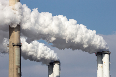 polution: Smoke emission from factory pipes Stock Photo