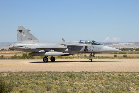 supersonic transport: ZARAGOZA, SPAIN - MAY 20,2016: Hungarian AIr Force Saab Gripen fighter jet taxiing after landing on Zaragoza airbase.