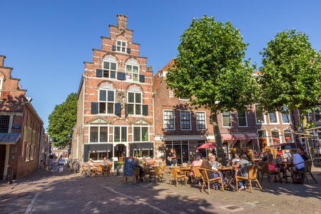 netherlands: OUDEWATER, THE NETHERLANDS - AUG 17, 2016: People on a terrace in the center of the historical village Oudewater.