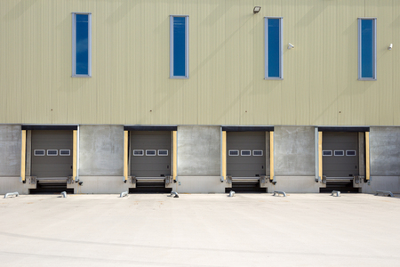 unloading: Trailer loading and unloading docks Stock Photo