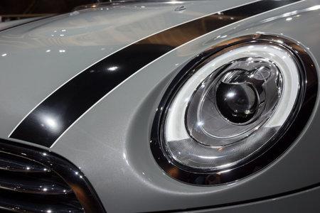 cooper: AMSTERDAM - APRIL 16, 2015: Mini Cooper headlight close up at the Amsterdam AutoRAI Motor Show.