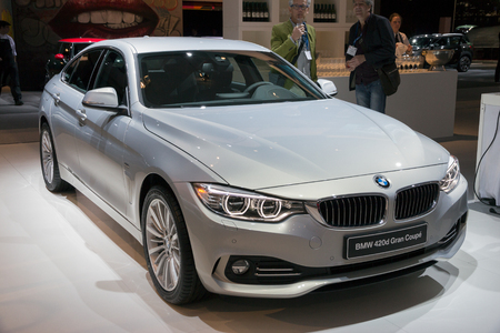 coupe: AMSTERDAM - APRIL 16, 2015: BMW 420d Gran Coupe on display at the Amsterdam AutoRAI Motor Show. Editorial