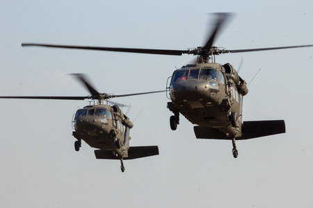 GRAVE, NETHERLANDS - SEP 17, 2014: Two American Army Blackhawk helicopter landing. Editorial