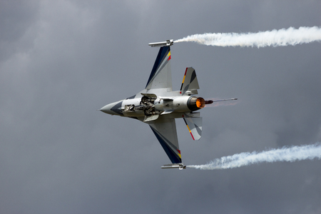 air demonstration: GILZE-RIJEN, NETHERLANDS - JUNE 20, 2014: Belgian Air Force F-16 solo display performing at the Dutch Air Force Open Day.