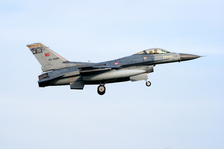 aircraft bomber: VOLKEL, NETHERLANDS - OCT 4, 2010: Turkish Air Force F-16 fighter jet landing on Volkel airbase.