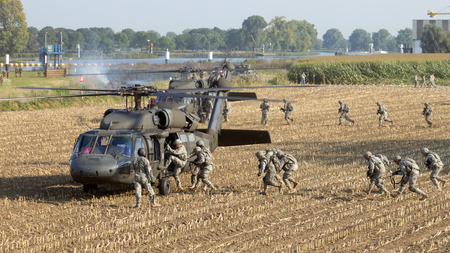 blackhawk helicopter: GRAVE, NETHERLANDS - SEP 17, 2014: 82 Airborne Div. soldiers enter Blackhawk helicopters at the Operation Market Garden memorial.