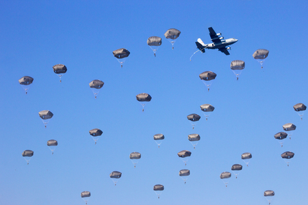 military invasion: paratrooper dropping Stock Photo