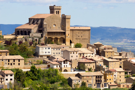 spain: View on the town Ujue (Uxue in Basque) and its 12th century fortified church in Navarre, Spain