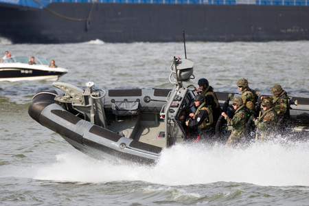 anti piracy: ROTTERDAM, NETHERLANDS - SEP 3, 2016: Dutch Marines in a speedboat during an assault demo at the World Harbor Days in Rotterdam.