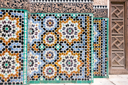 MARRAKECH, MOROCCO - APR 29, 2016: Mosaic detail in the inner court of the historical Ben Youssef Madrasa. A former Islamic college in Marrakech, Morocco.