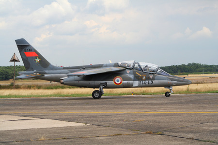 KLEINE BROGEL, BELGIUM - JULY 20, 2005: French Air Force Dassault Alpha Jet trainer jet taxiing from the runway after landing.