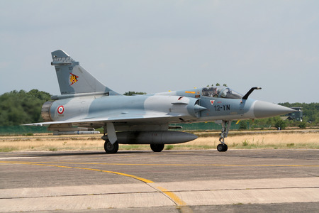 jetplane: KLEINE BROGEL, BELGIUM - JUL 20, 2005: French Air Force Mirage 2000 fighter jet taxiing from the runway after landing.