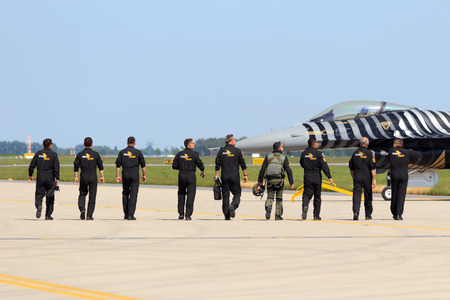 aerospace: BERLIN, GERMANY - MAY 21: Aircrew of the Turkish Air Force demonstration flight walk to their F-16 at the International Aerospace Exhibition ILA on May 21st, 2014 in Berlin, Germany. Editorial