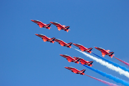 VOLKEL, NETHERLANDS - JUN 15, 2013: The RAF demonstration team Red Arrows performing aerobatics at the Royal Netherlands Air Force Open Day. Editorial