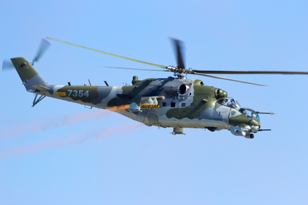 aerospace: BERLIN, GERMANY - MAY 22: Czech Air Force Mi-24V attack helicopter flying a demonstration at the International Aerospace Exhibition ILA on May 22nd, 2014 in Berlin, Germany.