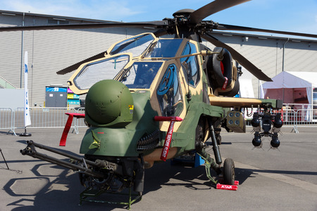 int: BERLIN, GERMANY - MAY 21: Turkish Aerospace Industries T129 Attack helicopter at the Int. Aerospace Exhibition ILA on May 21st, 2014 in Berlin, Germany. The helicopter is based on the Agusta A129.