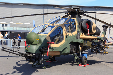aerospace: BERLIN, GERMANY - MAY 21: Turkish Aerospace Industries T129 Attack helicopter at the International Aerospace Exhibition ILA on May 21st, 2014 in Berlin, Germany. The helicopter is based on the Agusta A129 Mangusta.