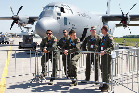 aircrew: BERLIN, GERMANY - MAY 21: Aircrew of the 37th AS from Ramstein airbase in front of their C-130J-30 Hercules at the International Aerospace Exhibition ILA on May 21st, 2014 in Berlin, Germany. Editorial