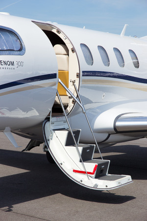messe: BERLIN, GERMANY - MAY 21: Light business jet Embraer EMB-505 Phenom 300 at the International Aerospace Exhibition ILA on May 21nd, 2014 in Berlin, Germany.