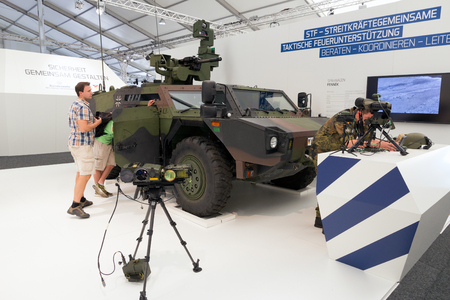 armoured: BERLIN, GERMANY - MAY 22: German Army Fennec (Light Armoured Reconnaissance Vehicle) at the International Aerospace Exhibition ILA on May 22nd, 2014 in Berlin, Germany.