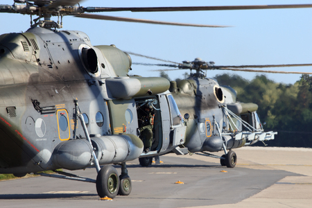 messe: BERLIN, GERMANY - MAY 22: Two Czech Air Force Mi-171 helicopters about to take off to perform a demonstration at the International Aerospace Exhibition ILA on May 22nd, 2014 in Berlin, Germany.