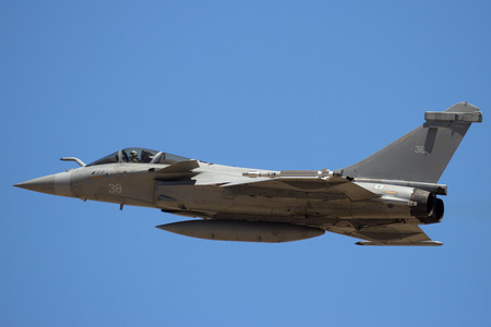 ZARAGOZA, SPAIN - MAY 20,2016: Dassault Rafale fighter jet from Flottille 11F of the French Navy in full flight on a blue sky