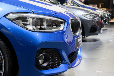 motor cars: BRUSSELS - JAN 19, 2017: Row of new BMW cars on display at the Motor Show Brussels.