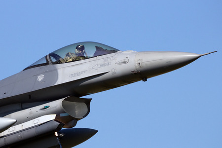 leeuwarden: LEEUWARDEN, THE NETHERLANDS - APR 11, 2016: Front view of an air force F-16 fighter jet landing.