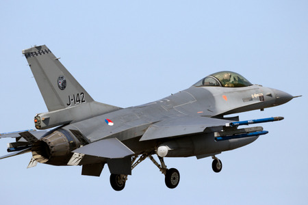 aircraft bomber: LEEUWARDEN, THE NETHERLANDS - APR 21, 2016: Royal Netherlands Air Force F-16 landing during exercise Frisian Flag.
