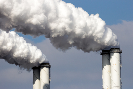 Smoke emission from factory pipes Stock Photo