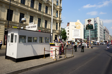 mauer: BERLIN, GERMANY - MAY 23, 2014: Tourists around the former Allied Checkpoint Charlie. Nowadays this site is a tourist attraction. Editorial