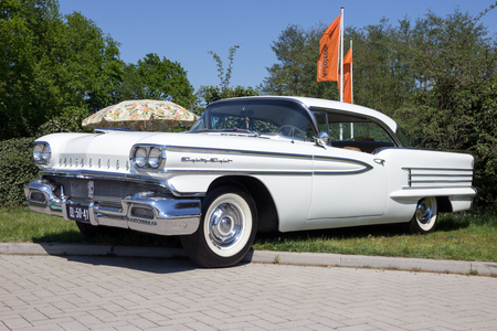 ROSMALEN, THE NETHERLANDS - MAY 8, 2016: Side view of a parked 1958 Oldsmobile Eighty Eight classic car. Editorial
