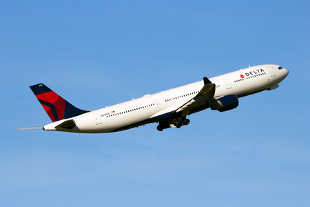 AMSTERDAM-SCHIPHOL - FEB 16, 2016: Delta Air Lines Airbus A330 airliner aircaft taking off from Schiphol airport