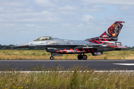SCHLESWIG-JAGEL, GERMANY - JUN 23, 2014: Special tiger painted Turkish Air Force F-16 fighter jet plane from 192Filo during the NATO Tiger Meet at Schleswig-Jagel airbase.