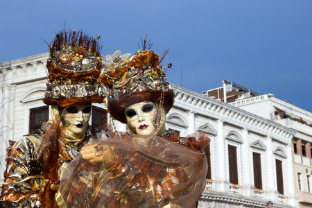 VENICE - FEB 6, 2013: Costumed people on the Piazza San Marco during Venice Carnival