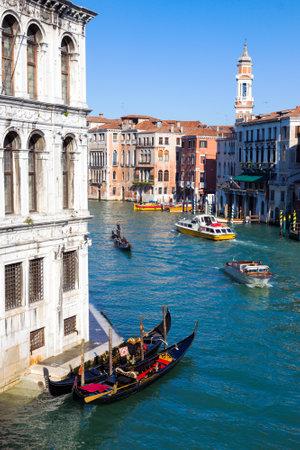 ITALY, VENICE - FEB 8, 2013: Gondolas on the Grand Canal seen from the Rialto bridge in Venice. Editorial