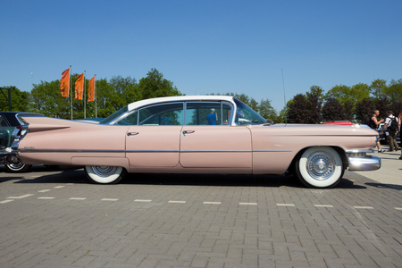 ROSMALEN, THE NETHERLANDS - MAY 8, 2016: Side view of a 1959 Cadillac Sedan De Ville classic car. Editorial