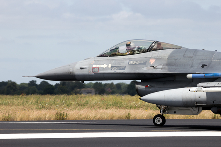 SCHLESWIG-JAGEL,  GERMANY - JUN 23, 2014: Lockheed Martin F-16 fighter jet plane on the runway during the NATO Tiger Meet at Schleswig-Jagel airbase.