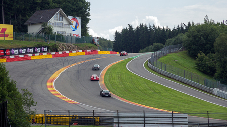 SPA, BELGIUM - AUG 5, 2014: Part of the Spa - Francorchamps race circuit in Spa, Belgium. The circuit is one of the most challenging race tracks, mainly due to its hilly and twisty nature. Редакционное