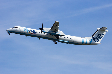 AMSTERDAM, NETHERLANDS - APRIL 21, 2015: Bombardier Dash 8 Q400 airplane from FlyBe taking off from SChilhol airport.