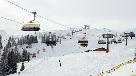 jet skier: FLACHAU, AUSTRIA - JAN 7, 2012: Ski lift cable booth going up the piste in the Austrian Alps. These pistes are part of the Ski Armada network, the largest of Europe. Editorial